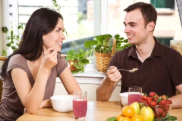 Couple with smoothies in kitchen