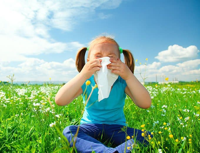Girl with allergy in a field