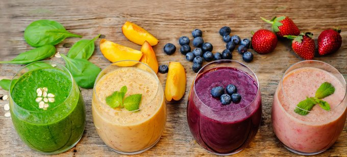 The picture of the smoothies combines colorful ingredients in the four glasses.