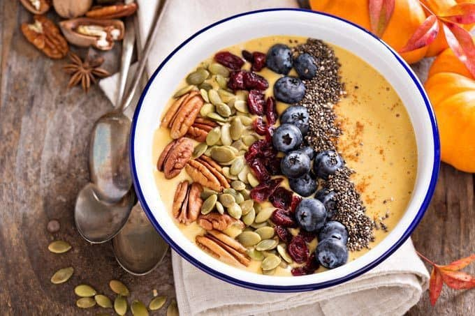 smoothie bowl with nuts seeds and grains